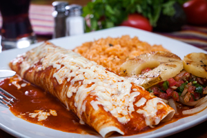 Red Chile Enchilada ~ Lightly fried corn tortilla stuffed with chorizo or chicken, cheese and onion, smothered with red chile sauce