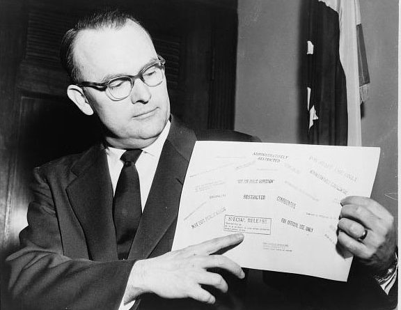 US Rep. John E. Moss (1915 – 1997) displays some of the secrecy stamps that appeared on classified documents. Moss (D-Calif.) might be said to be the father of the Freedom of Information Act in the USA.  Moss championed the federal Freedom of Information Act (FOIA) through multiple sessions of the United States House of Representatives where he served from 1953 to 1979.