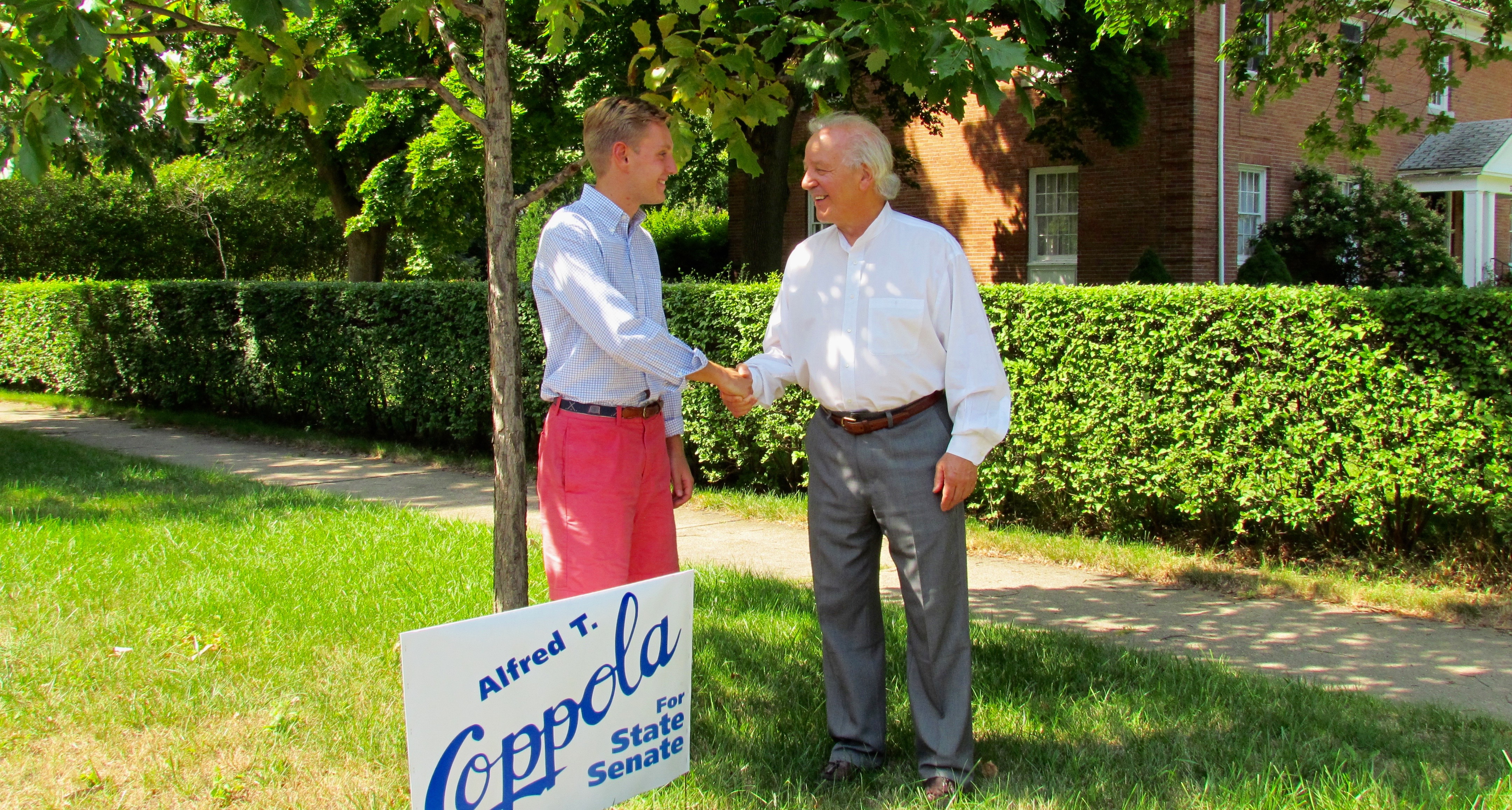 Coppola with his campaign manager, Sean Mathews, in the Parkside neighborhood of North Buffalo. Mathews is a pre-med student at Canisius College who knows Coppola as a fellow parishioner at St. Mark's.