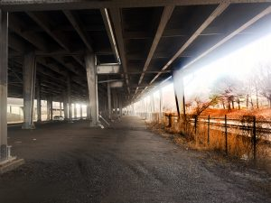 The waterfront is to the right but even though you can go under the thruway the train track prevents access to it