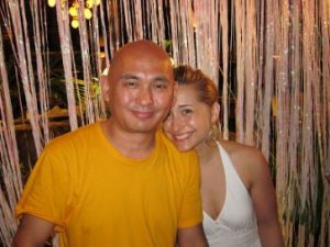Lama Tenzin with Raniere-disciple Allison Mack, at Necker Island.